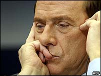 Italian Prime Minister Silvio Berlusconi, summit host