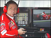 Ferrari boss Jean Todt keeps an eye on his rivals from the pit wall