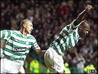Bobo Balde and Henrik Larsson celebrate