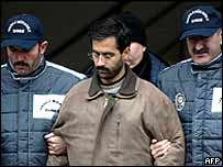 Suspect, identified only as FY (centre) is accompanied by two Turkish police officers