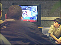 Egyptians watching news of Saddam Hussein's capture in Cairo