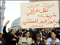 A group of men holding a congratulatory placard in central Baghdad