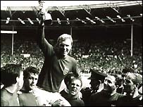 Bobby Moore parades the Jules Rimet trophy in 1966