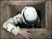 US soldier emerges from Saddam Hussein's tiny hideout