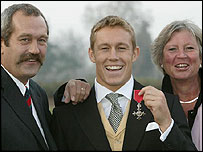 Jonny Wilkinson shows off his MBE with his father Phil and mother Philippa