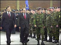 Macedonian President Boris Trajkovski, left, EU representative Solana and Concordia Commander General  Luis Nelson Ferreira Dos Santos inspect EU troops during a farewell ceremony