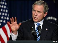 President Bush addresses a news conference on 15 December 2003