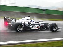 McLaren driver David Coulthard tires out Michelin's wet tyres during wet testing at Valencia