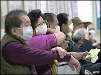 Local residents wearing masks wait for an appointment with their doctors at Taipei Municipal Hoping Hospital on 17 December
