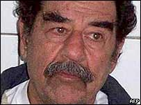 Saddam Hussein, pictured shaved after his arrest