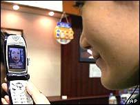 Japanese woman using a camera phone