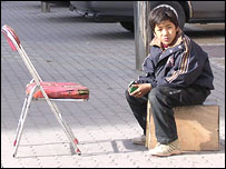 Uighur shoe shine boy