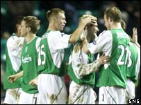 The Hibs players celebrate a famous win