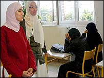 Sylvie Taleb (centre, glasses) with pupils in Lille school