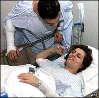 A woman is treated after a bomb attack in Riyadh