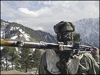 Indian soldier looks out over Kashmir's de facto border