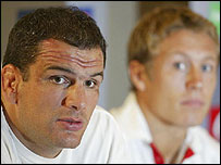 Jonny Wilkinson looks on as Martin Johnson speaks to the press