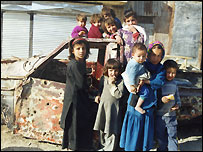 Children pose by a bullet-ridden car (Pic: Sohaila Esmat)