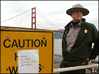 US National Park ranger stands guard in front of road leading to San Francisco's Golden Gate Bridge