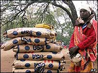 Zimbabwean woman with food aid