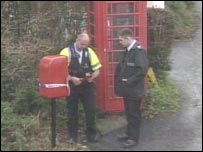 Policemen at vandalised post box