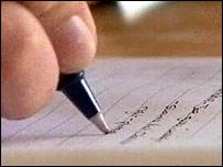 student writing exam script