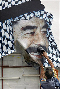 Saddam poster attacked