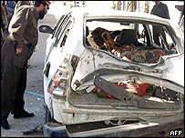 Wreckage of car after bomb attack in Kandahar, Afghanistan