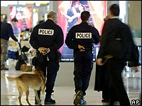 French police with sniffer dogs at Paris Roissy airport