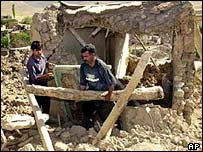 Rescuers search debris after earthquake in June, 2002