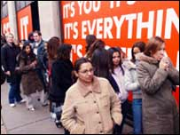 Shoppers queue outside Selfridges in Oxford Street