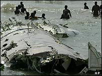 Wreckage of crashed plane in surf