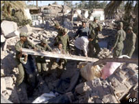 Iranian soldiers searching for survivors
