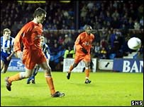 Jim McIntyre scores from the penalty spot