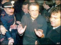 Romano Prodi outside his home after the explosion