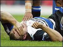 Mike Tindall lies in agony after suffering an ankle injury