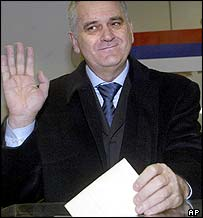 Radical Party deputy leader Tomislav Nikolic votes