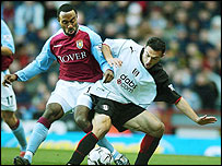 Darius Vassell and Steed Malbranque do battle