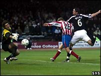 Julian Speroni is helpless as Michael Ball's free kick curls in