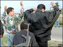 File photo of men being arrested in 1995