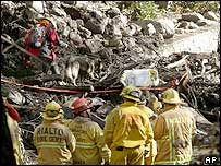 Recovery workers at the scene of a deadly mudslide in California