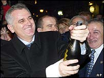 SRS deputy leader Tomislav Nikolic celebrates the election win