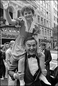 Giving a lift to nine-year-old singer Toni Warne from Ipswich outside the London Palladium