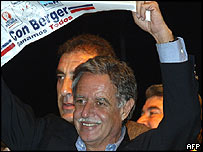President-elect of Guatemala Oscar Berger waves a flag in victory after hearing early results