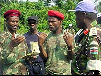 Lurd rebel commanders (l) with Unmil leader General Opande (r)
