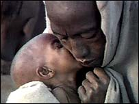 A starving Ethiopian child and parent outside an aid centre
