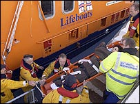Rescuers taking one of the women off the liner