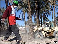 An Iranian Red Crescent worker picks his way through the rubble