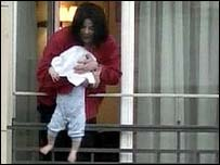 Michael Jackson dangles his baby over a hotel balcony in Germany