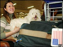 American Heather Ekas, 25, waits to be checked at Cumbica Airport in Sao Paulo after flying in from Chicago